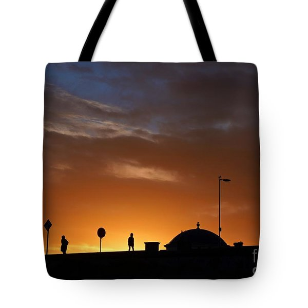 Tote Bag featuring the photograph Walking At Sunset by Les Bell