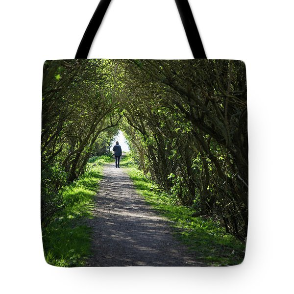 Tote Bag featuring the photograph Walking In A Narrow Alley by Kennerth and Birgitta Kullman