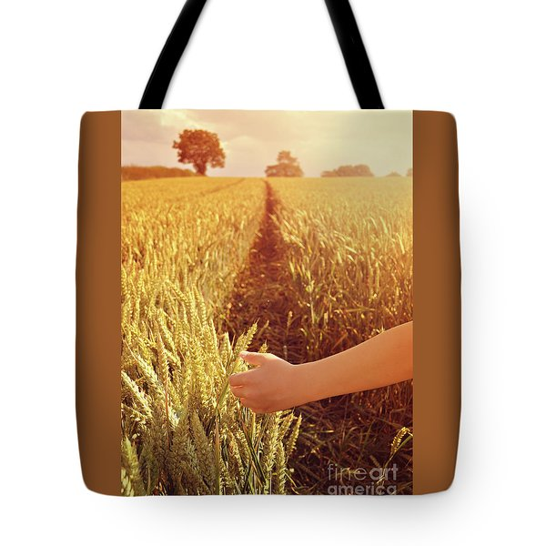 Tote Bag featuring the photograph Walking Through Wheat Field by Lyn Randle