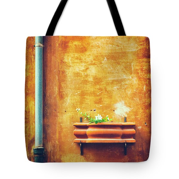 Tote Bag featuring the photograph Wall Gutter Vase by Silvia Ganora