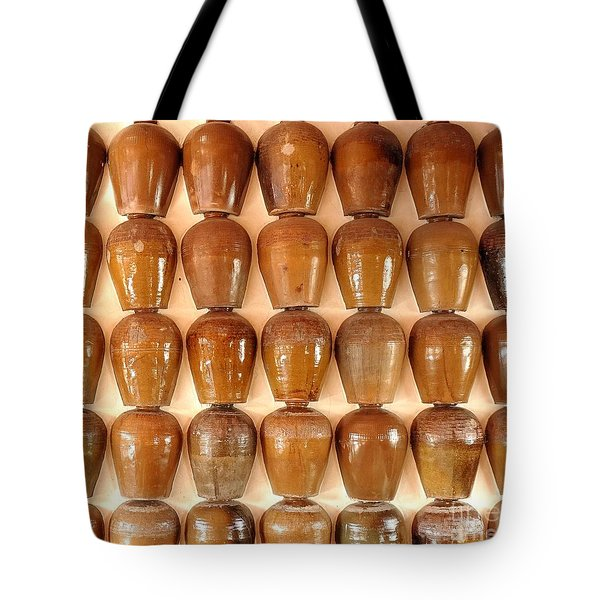 Tote Bag featuring the photograph Wall Of Ceramic Jugs by Yali Shi
