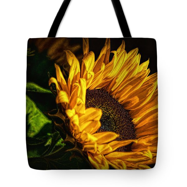 Tote Bag featuring the photograph Warmth Of The Sunflower by Michael Hope