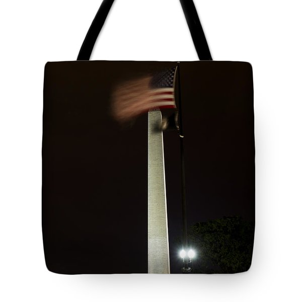 Tote Bag featuring the photograph Washington Monument At Night With Flag by Angela DeFrias