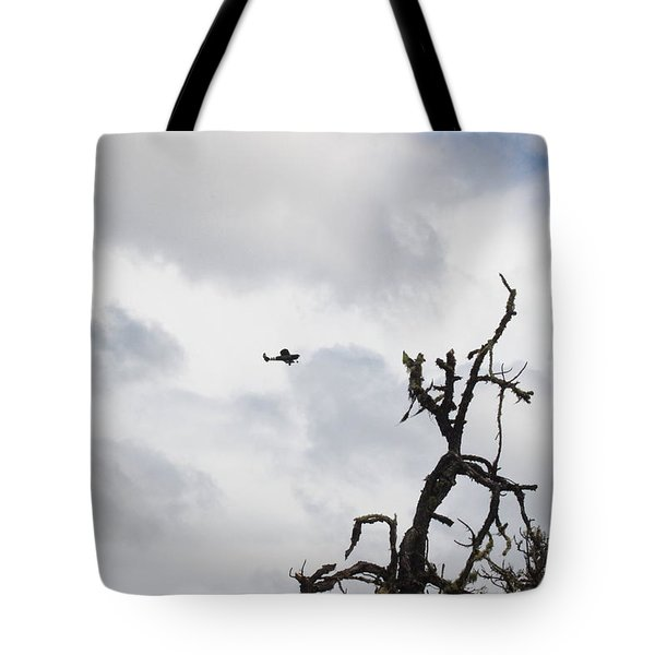 Tote Bag featuring the photograph Watch Out For That Tree by Marie Neder