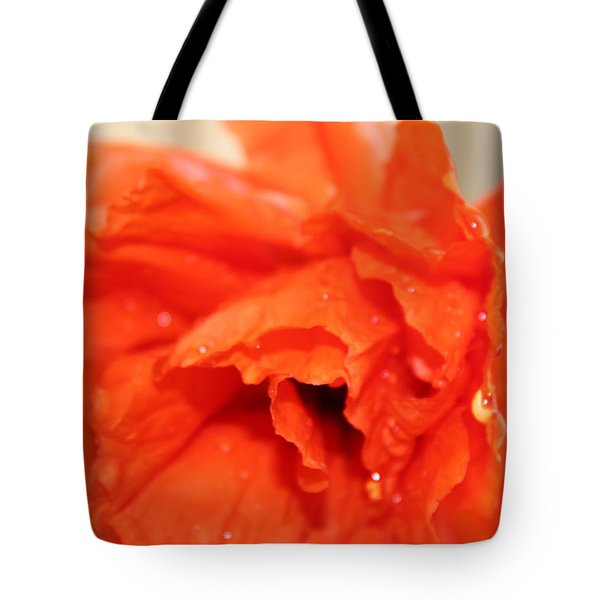 Tote Bag featuring the photograph Water On Orange by Christin Brodie