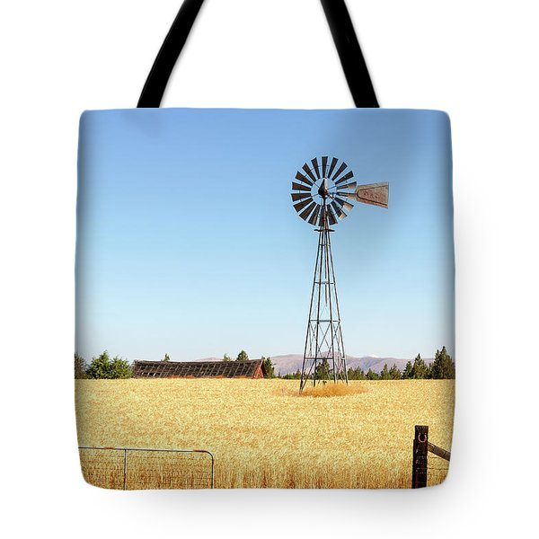 Water Pump Windmill At Wheat Farm In Rural Oregon Tote Bag by David Gn
