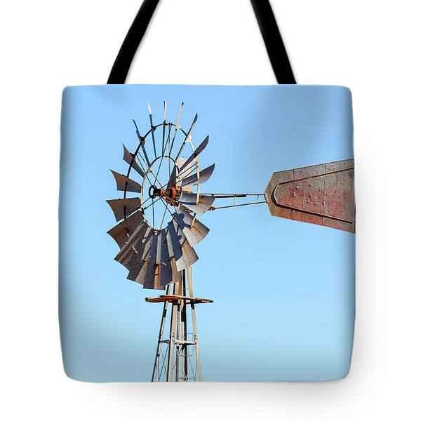 Water Pump Windmill On Blue Sky Background Tote Bag by David Gn