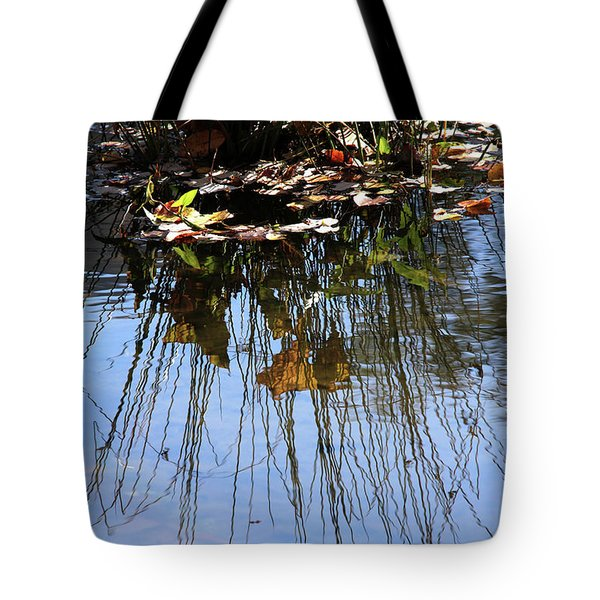 Water Reflection Of Plant Growing In A Stream Tote Bag by Emanuel Tanjala
