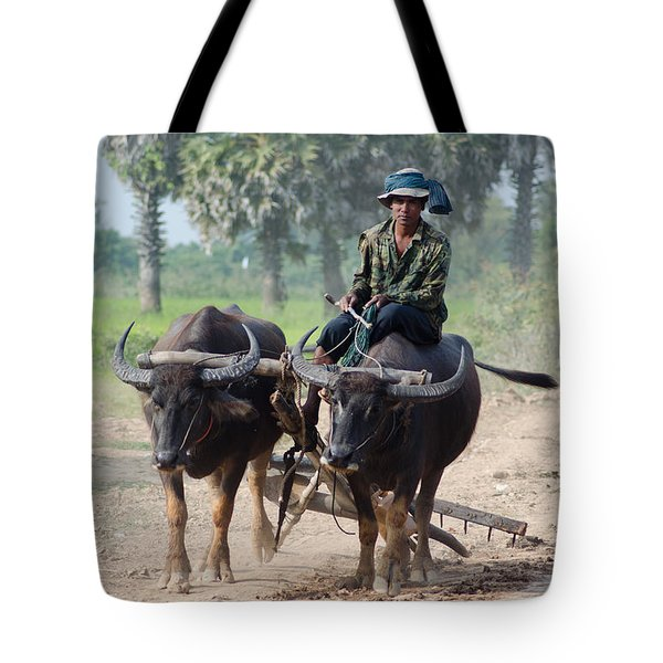 Waterbuffalo Driver Returns With His Animals At Day's End Tote Bag