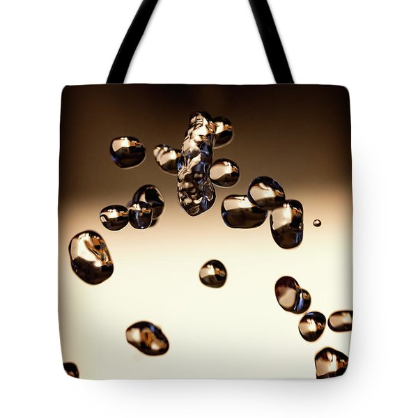 Tote Bag featuring the photograph Waterdrops I by Rico Besserdich