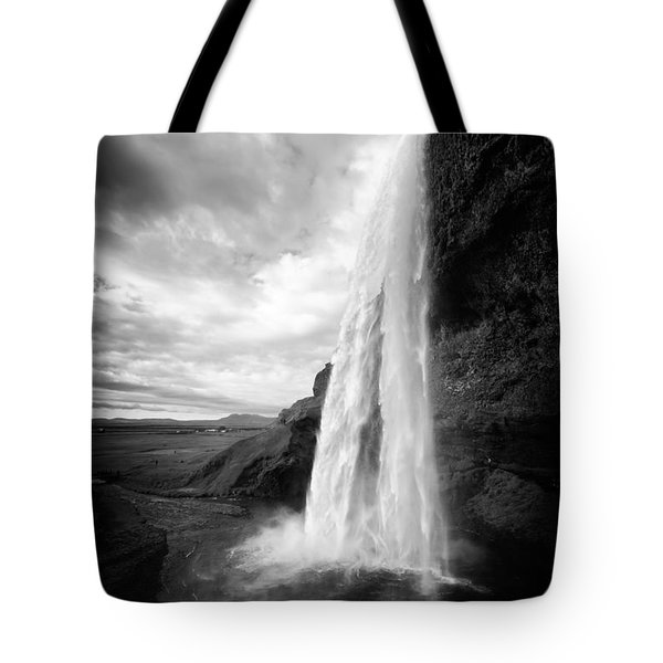 Tote Bag featuring the photograph Waterfall In Iceland Black And White by Matthias Hauser