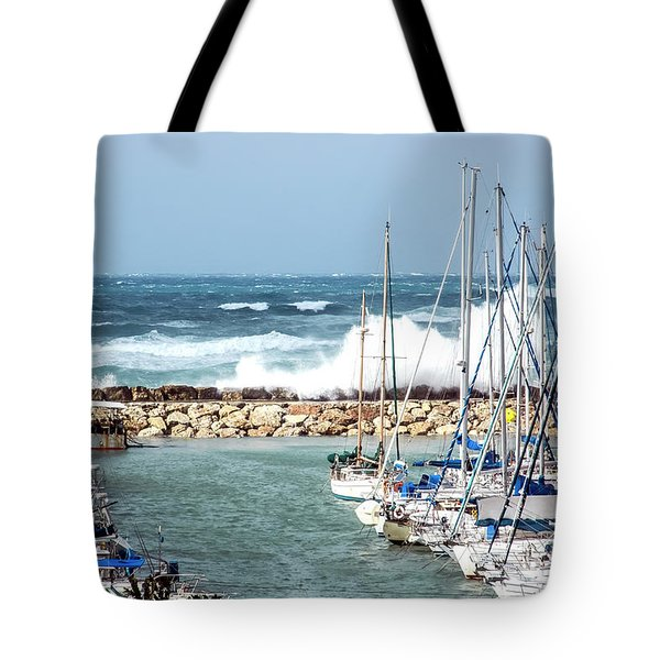 Wave Breaking Into The Harbour Tote Bag