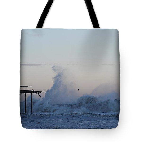 Wave Towers Over Oc Fishing Pier Tote Bag by Robert Banach