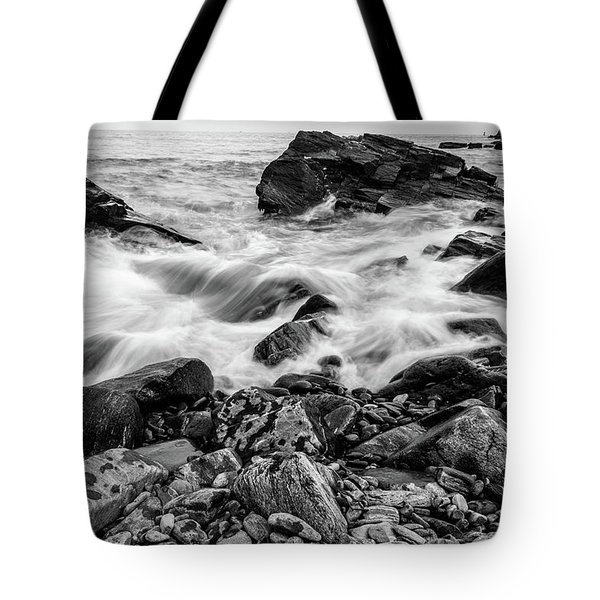 Waves Against A Rocky Shore In Bw Tote Bag
