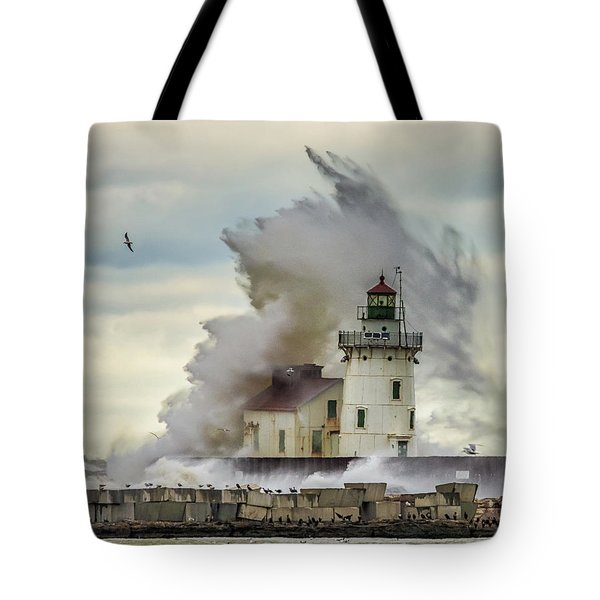 Waves Over The Lighthouse In Cleveland. Tote Bag