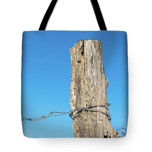 Tote Bag featuring the photograph Weathered Old Post With Barbwire by Kennerth and Birgitta Kullman