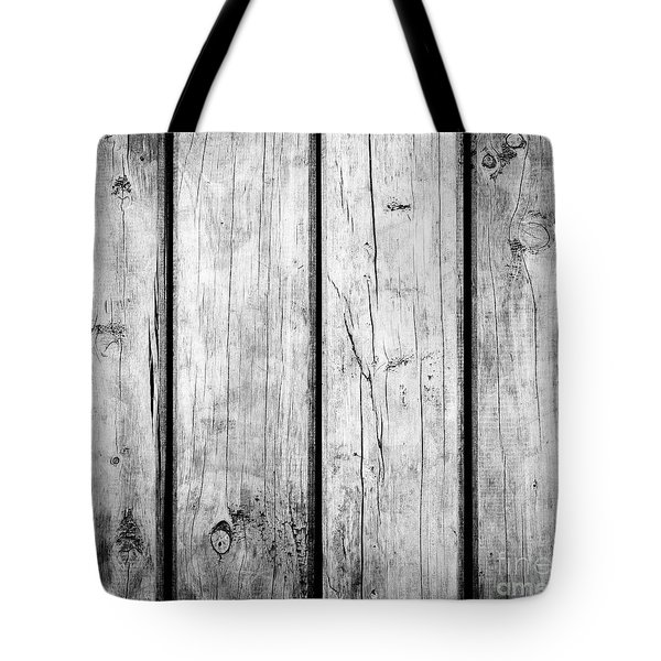 Tote Bag featuring the photograph Weathered Wooden Background Black And White by Tim Hester