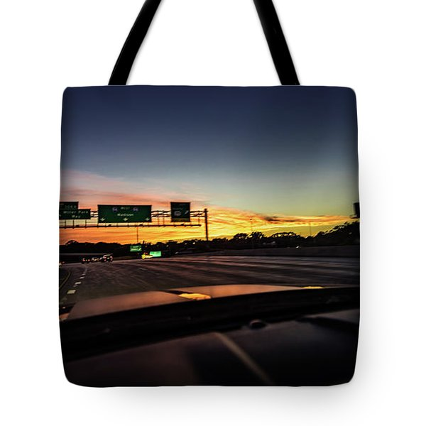 Tote Bag featuring the photograph Westbound by Randy Scherkenbach
