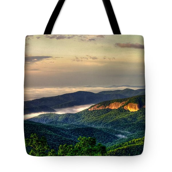 Tote Bag featuring the photograph Looking Glass Rock Sunrise Between The Clouds Blue Ridge Parkway by Reid Callaway