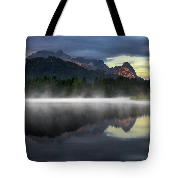 Wetterstein Mountain Reflection During Autumn Day With Morning Fog Over Geroldsee Lake, Bavarian Alps, Bavaria, Germany. Tote Bag