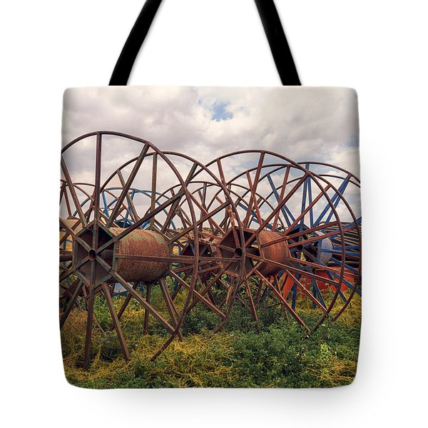 Tote Bag featuring the photograph Wheels by Uri Baruch
