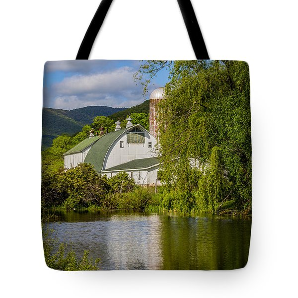 Tote Bag featuring the photograph White Barn Reflection In Pond by Paula Porterfield-Izzo