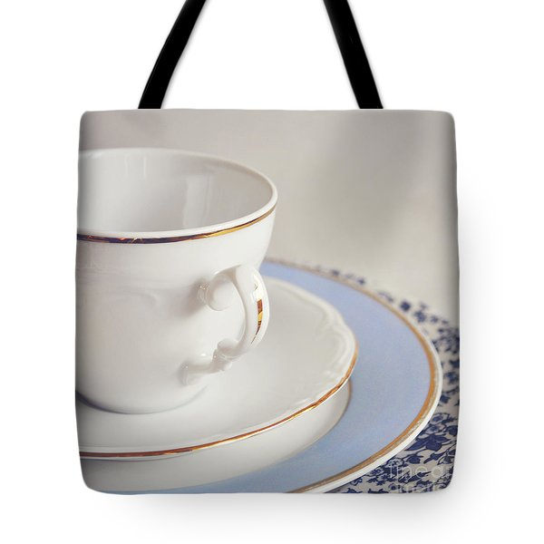 Tote Bag featuring the photograph White China Cup, Saucer And Plates by Lyn Randle