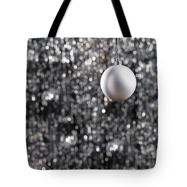 Tote Bag featuring the photograph White Christmas Bauble  by Ulrich Schade