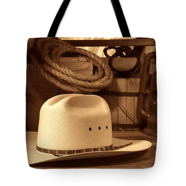 White Cowboy Hat On Workbench Tote Bag