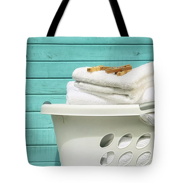 White Laundry Basket With Towels And Pins Tote Bag