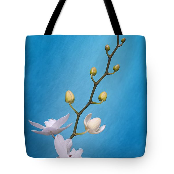White Orchid Buds On Blue Tote Bag