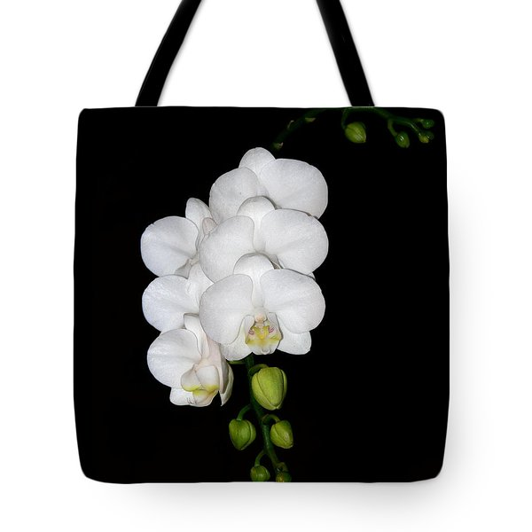 Tote Bag featuring the photograph White Orchids On Black by Michele A Loftus
