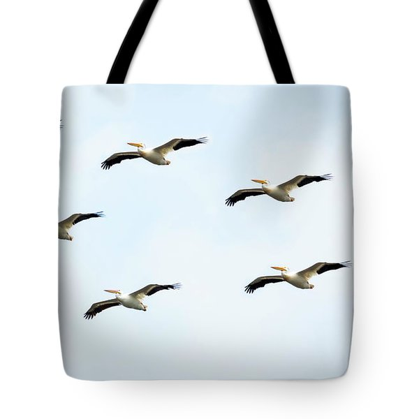 Tote Bag featuring the photograph White Pelican Flyby by Ricky L Jones