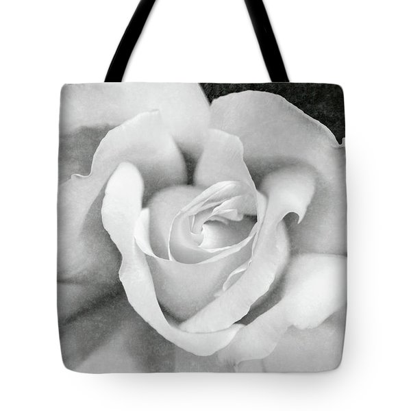 Tote Bag featuring the photograph White Rose Macro Black And White by Jennie Marie Schell