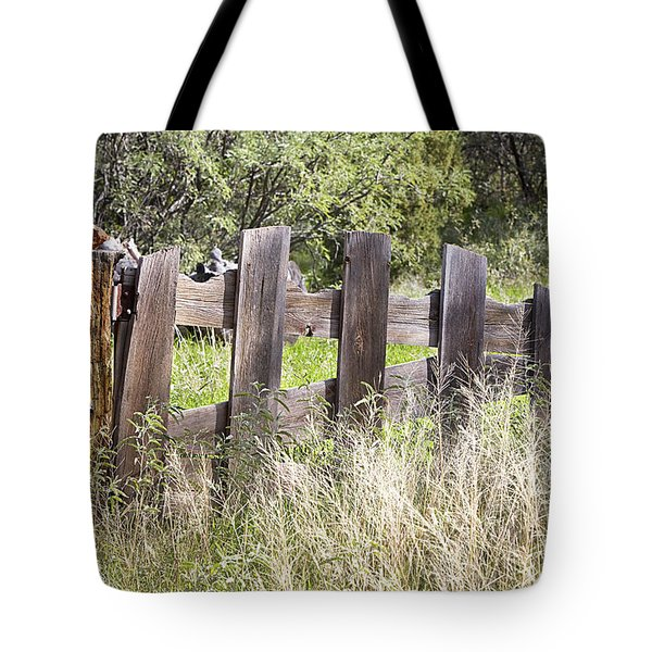 Tote Bag featuring the photograph Who Ate The Fence by Phyllis Denton