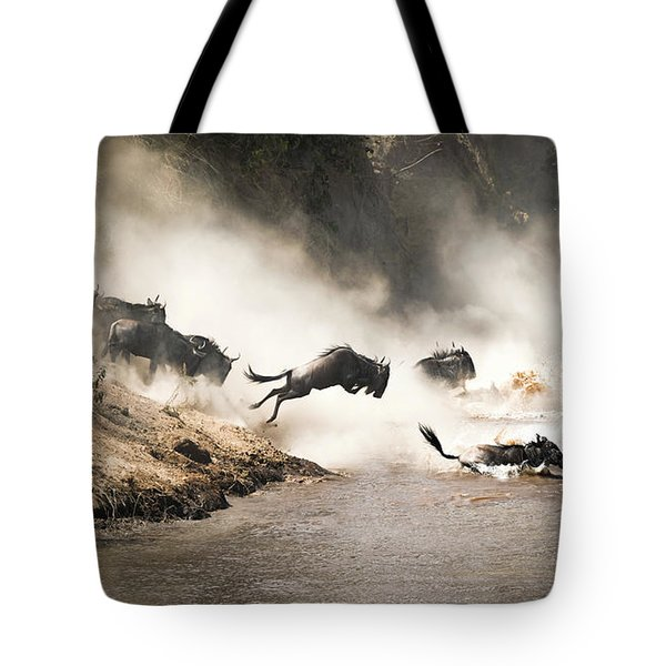 Wildebeest Leap Of Faith Into The Mara River Tote Bag