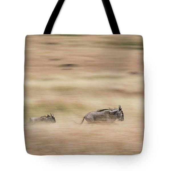 Wildebeest Running Through Grasslands - Panning Blur Tote Bag