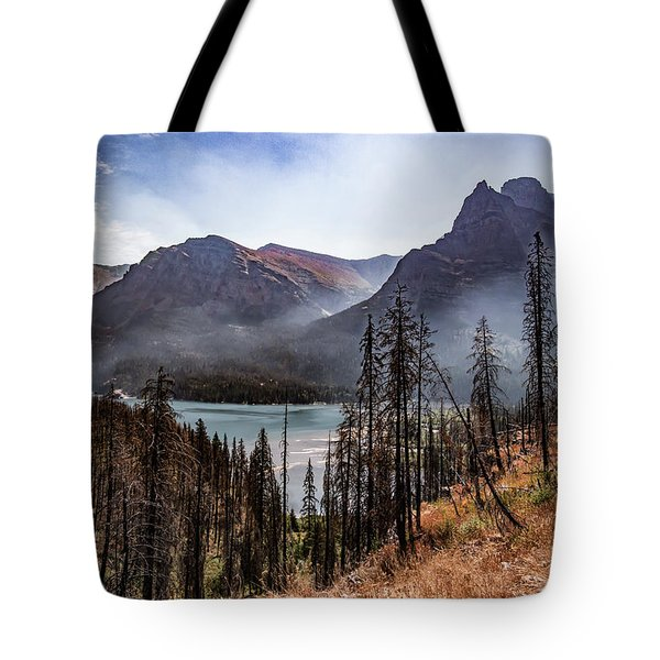 Tote Bag featuring the photograph Wildfire Remnants Overlooking St. Mary's Lake, Glacier National Park by Lon Dittrick