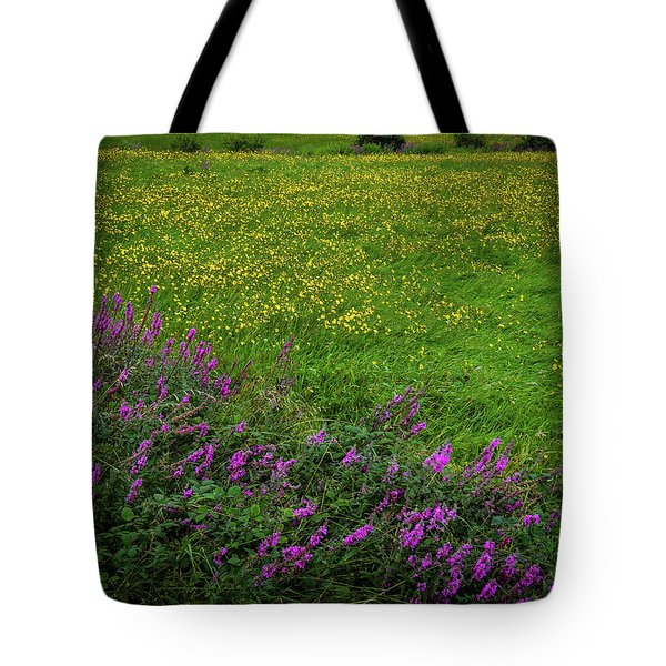 Tote Bag featuring the photograph Wildflowers In An Irish Field by James Truett