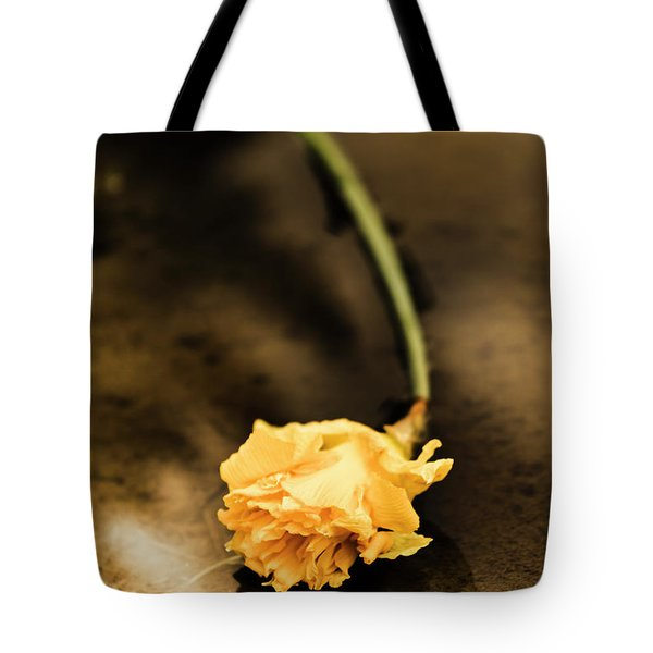 Wilting Puddle Flower Tote Bag