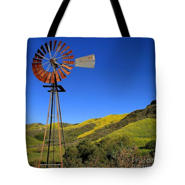 Tote Bag featuring the photograph Windmill by Henrik Lehnerer