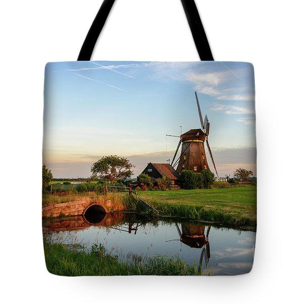 Tote Bag featuring the photograph Windmill In The Countryside In Holland by IPics Photography