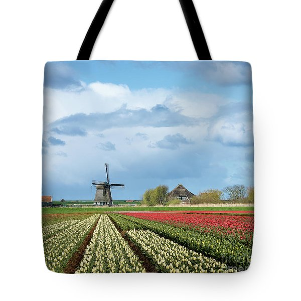 Tote Bag featuring the photograph Windmill With Tulip Flower Fields In The Countryside by IPics Photography