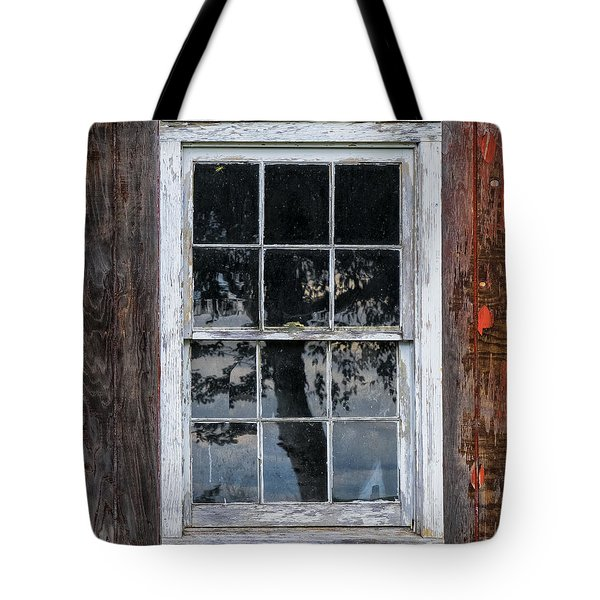 Tote Bag featuring the photograph Window Reflection by Tom Singleton