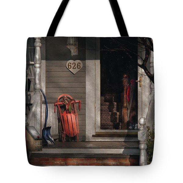 Winter - Rosebud And Shovel Tote Bag by Mike Savad