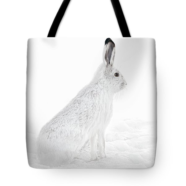 Tote Bag featuring the photograph  Winter Snowshoe Hare by Jennie Marie Schell