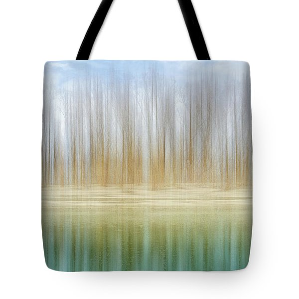 Winter Trees On A River Bank Reflecting Into Water Tote Bag