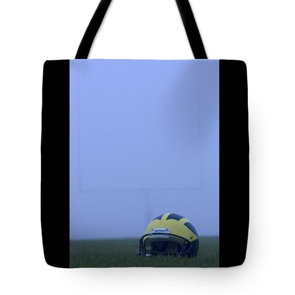Wolverine Helmet On The Field In Heavy Fog Tote Bag