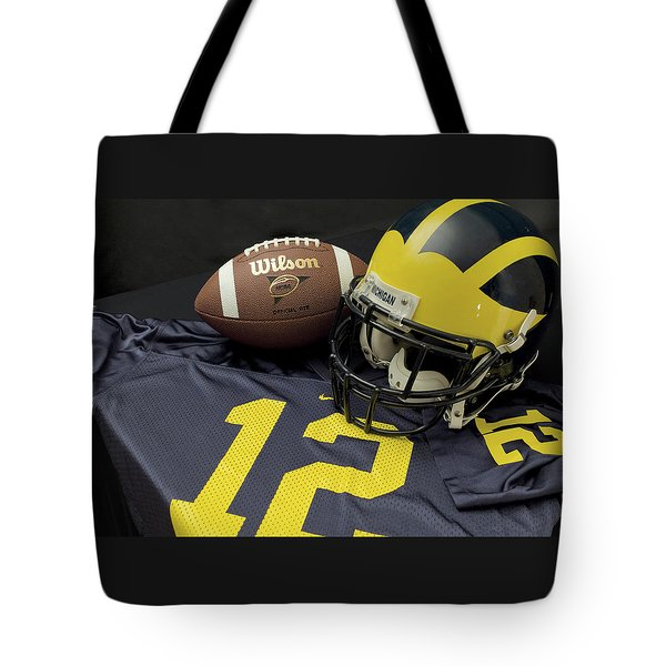 Wolverine Helmet With Football And Jersey Tote Bag
