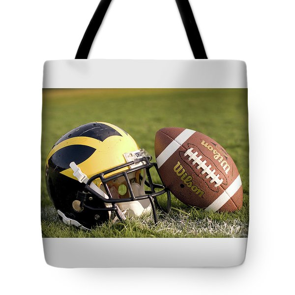 Wolverine Helmet With Football On The Field Tote Bag
